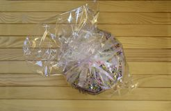 Easter cupcake in a package on a wooden background. Top view Stock Photos