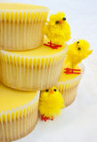 Easter cupcake tower. Tower of yellow lemon cupcakes and cute Easter chicks royalty free stock photos