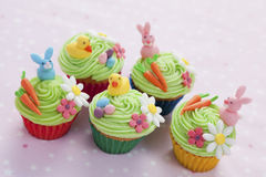 Easter cupcakes. Five easter themed cupcakes with bunnies, chicks, eggs, carrots and flowers Stock Photography