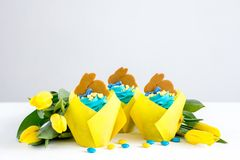 Easter cupcakes with blue cream royalty free stock images