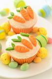 Easter cupcakes with candy carrots Royalty Free Stock Photo