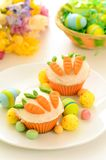 Easter cupcakes with candy carrots Royalty Free Stock Image