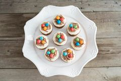 Easter cupcakes with chocolate frosting and candy eggs Royalty Free Stock Images