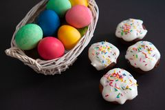 Easter cupcakes and colorful painted eggs. For easter celebration stock photography