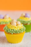 Easter cupcakes decorated with eggs in nest Stock Image