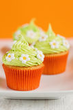 Easter cupcakes decorated with flowers Stock Image