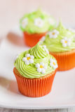 Easter cupcakes decorated with flowers on white plate Stock Photo