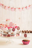 Easter cupcakes decorated with pink candy, paper eggs and ribbon Royalty Free Stock Photos