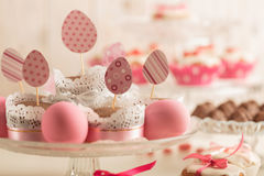 Easter cupcakes decorated with pink candy, paper eggs and ribbon Royalty Free Stock Image