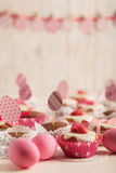 Easter cupcakes decorated with pink candy, paper eggs and ribbon Royalty Free Stock Images
