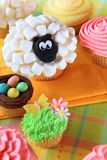 Easter cupcakes and Easter eggs Stock Photos