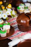 Easter cupcakes and Easter eggs. Easter cupcakes and Easter on table royalty free stock images