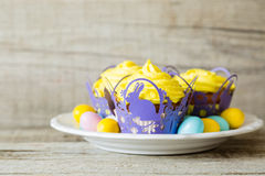 Easter cupcakes with eggs and flaffy willow Royalty Free Stock Images