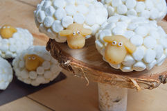 Easter cupcakes or marshmallow sheeps Stock Image