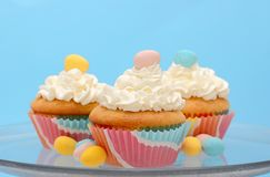 Easter cupcakes topped with pastel colored chocolate candy eggs Stock Photography