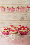 Easter cupcakes with white icing decorated with pink candy and r Royalty Free Stock Images