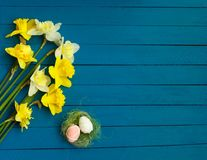 Easter - Daffodils And Eggs With Old Wooden Background stock photos