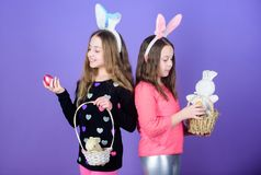 Easter day. Easter activities for children. Happy easter. Holiday bunny girls with long bunny ears. Egg and bunny. Holiday attribute. Sisters celebrate easter royalty free stock photo