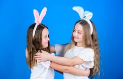 Easter day celebration. Little girls enjoy festive celebration. Cute sister dancing at family celebration. Happy holiday. Celebration royalty free stock images