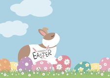 Easter day design of rabbit and eggs with flowers on grass royalty free stock photography