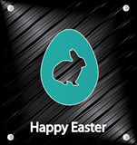 Easter Day poster. Blue egg with rabbit on metal background Stock Images