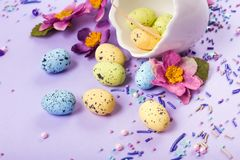 Easter decor in pastel colors. Easter eggs, candy, sweets, flowers and eggshells. stock photo