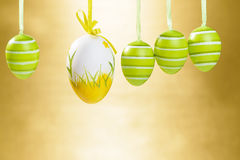 Easter decorated eggs on elegant gold background. Royalty Free Stock Image