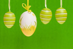 Easter decorated eggs  on green backgound. Stock Photos