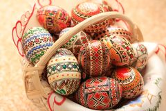 Easter Decorated Eggs traditional multiple colors. Decorated eggs in a basket. Traditional Easter eggs painted with multiple colors. Red, green, blue, brown and Royalty Free Stock Photos