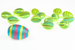 Easter decorated striped eggs on white background. Stock Photos
