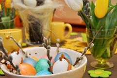Easter decorated table - eggs bowl Royalty Free Stock Photos