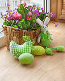 Easter decorating of balcony. Easter decorating of window by a rabbit and spring flowers Stock Images