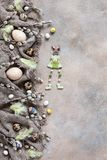 Easter decoration – natural eggs and willow. Top view, close up, flat lay on light concrete background.  royalty free stock photography