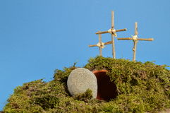 Easter decoration – resurrection garden. Resurrection garden as easter decoration with a stone near the empty tomb and three crosses on a hill above stock photos