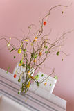 Easter decoration. Vase with branches includes eggs and rabbits as decoration for Easter Royalty Free Stock Photo