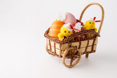 Easter Decoration. Eggs, carriage, little yellow chicks stock photos