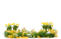 Easter decoration. With straw rabbits, eggs and daffodils flowers royalty free stock images