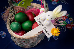 Easter Decoration. Easter basket decoration with Easter sign on blue Easter background stock photos