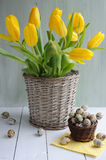 Easter decoration. Basket of  tulips and easter eggs Royalty Free Stock Photography