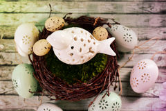 Easter decoration with bird in nest Royalty Free Stock Photo