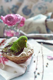 Easter decoration - bird in a nest with lace, pink roses. And willow branches, natural light toned photo Stock Image