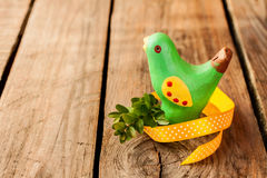 Easter decoration - bird on vintage rustic wood Royalty Free Stock Photos