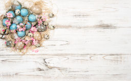 Easter decoration with blue eggs and pink flowers Royalty Free Stock Images