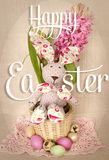 Easter decoration with bunny rabbit in basket, eggs and spring hyacinth flower Royalty Free Stock Images