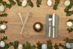 Easter decoration, champagne glasses, napkin, fork and knife Stock Image