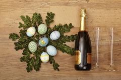 Easter decoration, champagner bootle and champagne glasses on wood Stock Image