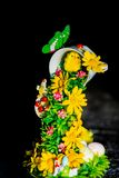 Easter decoration with chick and eggs on dark background. Vertical image. Home decoration for april Easter holiday royalty free stock images