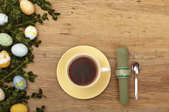 Easter decoration, coffee cup, napkin and spoon Royalty Free Stock Photo