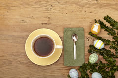 Easter decoration, coffee cup, napkin and spoon on wood Royalty Free Stock Photography