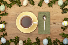 Easter decoration, coffee cup, napkin and spoon on wood Stock Photo